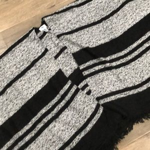 Black and grey shall-open poncho